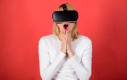 The woman with glasses of virtual reality. Woman wearing virtual reality goggles. Woman using virtual reality headset. VR science stock photography