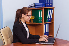 Woman in glasses working by the laptop, business concept Royalty Free Stock Photo