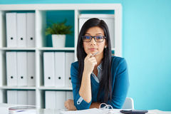 Woman with glasses working in office Stock Image