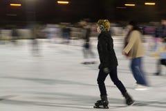 woman-gliding-on-ice-at-skating-rink Royalty Free Stock Photos