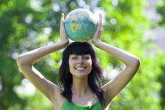 Woman with global. Beautiful brunet woman with global Royalty Free Stock Image