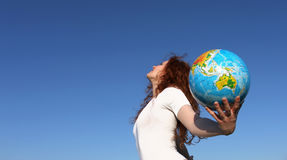 Woman with globe stock images