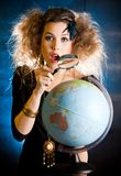 Woman with a globe Royalty Free Stock Photo