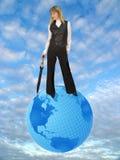 Woman on globe stock image