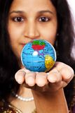 Woman with a globe. In her hand Stock Image