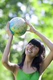 Woman with globe. Beautiful brunette woman holding globe Royalty Free Stock Photo