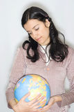 Woman with globe Stock Image