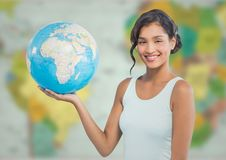 Woman with globe against blurry map Stock Image
