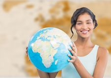 Woman with globe against brown blurry map Royalty Free Stock Photography