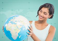 Woman with globe against green map Royalty Free Stock Photography