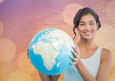 Woman with globe against map with bokeh Stock Photos