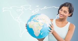 Woman with globe against white map and blue background Stock Photos