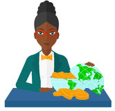 Woman with globe full of money Royalty Free Stock Photo