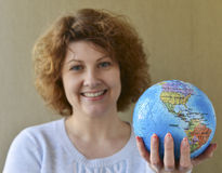Woman with globe in hands thinking about traveling Royalty Free Stock Images