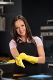 Woman in gloves cleaning modern kitchen Royalty Free Stock Photography