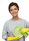 Woman in gloves cleaning plate Stock Image