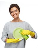Woman in gloves cleaning plate Stock Photos