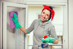 Woman in gloves cleaning window Stock Photo