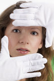 Woman with gloves frames her face Stock Photo
