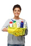 Woman in gloves holding different cleaning stuff Stock Image