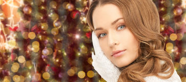 Woman in gloves over christmas lights background Stock Photography