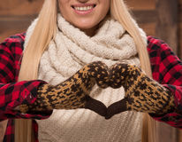 Woman in gloves show love sign Royalty Free Stock Images