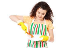 Woman in gloves washing dishes Stock Photo