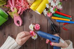 Woman glue handmade flowers with melt gun Royalty Free Stock Photo