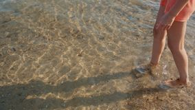 Woman go into the clear sea water stock video