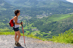 Woman go hiking in the mountains Stock Image