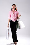 Woman go shopping. Young woman happily shopping full of paper bags Royalty Free Stock Photo
