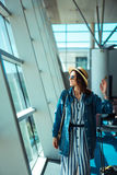 Woman go travel with suit case at airport Royalty Free Stock Image