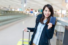 Woman go traveling with her suitcase and holding passport Royalty Free Stock Photos