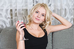 Woman with goblet of wine Royalty Free Stock Images