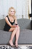 Woman with goblet of wine Stock Photography