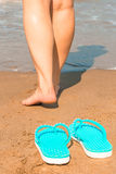 Woman goes barefoot on the sand Stock Images