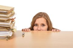 Woman goes behind the desk in the knee Stock Photo