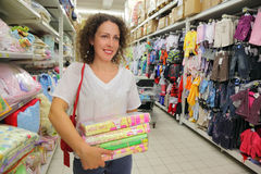 Woman goes in big store Stock Images