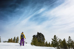 A woman goes Hiking in winter mountains on Sunny day Royalty Free Stock Image