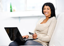 Woman goes online shopping Royalty Free Stock Photo