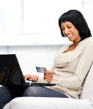 Woman goes online shopping Stock Photos