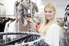 Woman goes shopping Royalty Free Stock Photos