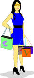 Woman goes shopping. Woman dressed in blue dress and black belt holds shopping bags Royalty Free Stock Images