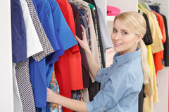 Woman goes shopping in a store Stock Photos