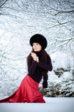Woman goes on snow. Pretty woman goes on snow and turns around Royalty Free Stock Photo