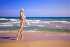 Woman goes to the beach Stock Photos