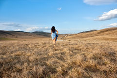 Woman goes to grass by the road Royalty Free Stock Image