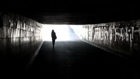 Woman Goes Through an Underpass stock footage