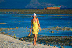 Woman goes for a walk at sundown on the beach Royalty Free Stock Photos