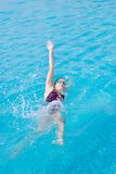 Woman in goggles swimming back crawl style Royalty Free Stock Photography